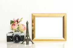 Golden picture frame rose flowers vintage camera Paris travel. Golden picture frame, rose flowers and vintage camera. Paris travel concept Royalty Free Stock Images