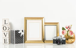 Golden picture frame, rose flowers and vintage camera. Retro sty Stock Photography