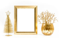Golden picture frame and shiny christmas ornaments Stock Photography