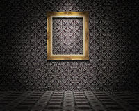 Golden picture frame on the wall Stock Images
