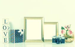 Golden picture frames, flowers and vintage camera. Retro style Royalty Free Stock Images
