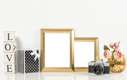 Golden picture frames, roses flowers and vintage camera. Retro d Royalty Free Stock Photography