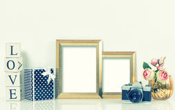 Golden picture frames, roses flowers and vintage camera. Retro s Stock Image
