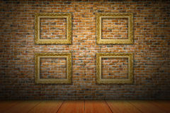 Golden picture frames on yellow brick wall Stock Images