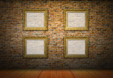 Golden picture frames on yellow brick wall Royalty Free Stock Photography