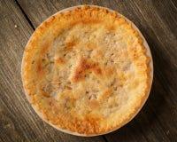 Golden Pie on Rustic Barnwood Royalty Free Stock Photos