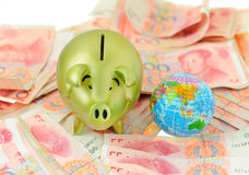 Golden pig  bank and rmb bill Stock Images
