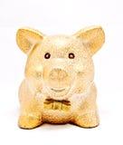 A golden piggy bank. On white background Stock Photos