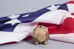 Golden Piggy Bank  with American Flag Stock Image