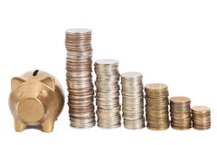 Golden piggy bank with coins arranged as a graph. Isolated Royalty Free Stock Photography