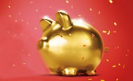 Golden piggy bank or golden moneybox Royalty Free Stock Photography
