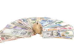 Golden piggy bank with International currencies Stock Image