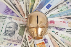 Golden piggy bank with money Royalty Free Stock Photo