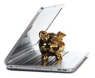 Golden piggy bank on notebook Royalty Free Stock Photos