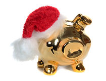 Golden piggy bank with red jelly bag cap Royalty Free Stock Images