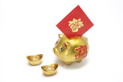 Golden Piggy Bank with Red Packet. On White Background Royalty Free Stock Photography