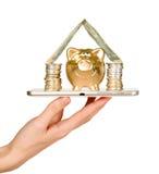 Golden piggy bank on top of mobile phone screen Stock Photos