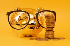 Free Golden Piggy Bank Wearing Glasses With Money Towers. Stack Of Euro Coins Near Golden Money Box. Money Pig, Money Saving, Moneybox Stock Image - 188256301