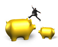 Golden piggy banks with man jumping Royalty Free Stock Photos