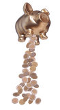 Golden piggybank with falling coins Royalty Free Stock Photo