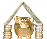 Golden piggybank with money home Royalty Free Stock Images