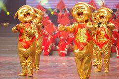 Golden piglet dances-2007 Jiangxi Spring Festival Gala. Jiangxi Art Theater Dance flying, Ambilight, showing a bursting with happiness atmosphere of the festival Stock Photos