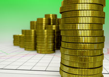 Golden piles of coin on green background Royalty Free Stock Images