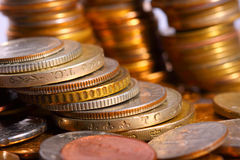 Golden piles of coins Royalty Free Stock Image