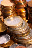 Golden piles of coins Stock Photography