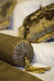 Golden pillows. On a classic styled bed Royalty Free Stock Photos