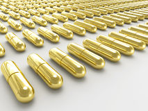 Golden pills Royalty Free Stock Photography