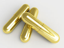 Golden pills Royalty Free Stock Photo