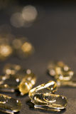 Golden pills Stock Images