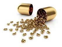 Golden pills Stock Images