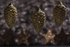 Golden pine cone ornaments with bokeh Royalty Free Stock Photo