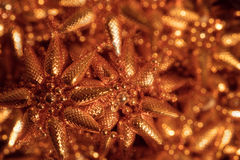 Golden pine cones christmas decoration. Golden, star shaped pine cones christmas decoration Royalty Free Stock Photography