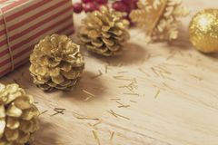 Golden pine cones glittered christmas and gift box decoration stock images