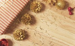 Golden pine cones glittered christmas and gift box decoration stock photo