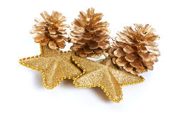 Golden pine cones and stars macro isolated Stock Photos