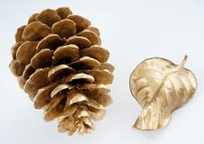 Gold pinecone and gold leaf. Christmas decoration. isolated on white background Stock Image