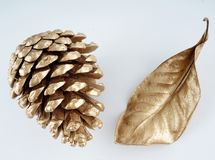 Gold pinecone and gold leaf. Christmas decoration. isolated on white background Stock Images