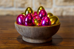 Golden and pink easter eggs Stock Photos