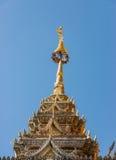 Golden pinnacle of the old pagoda Stock Photos