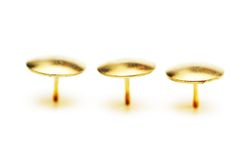 Golden pins isolated Royalty Free Stock Photos