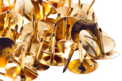 Golden pins. Some nice golden pins close up with white background Royalty Free Stock Photos