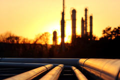 Golden pipe system against the sun in oil crude refinery Stock Image