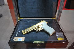 Golden Pistol Display in Abu Dhabi International Hunting and Equestrian Exhibition 2013 Stock Image