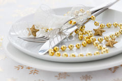 Golden place setting. For christmas Stock Images