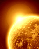 Golden planet earth in outer space Stock Photo