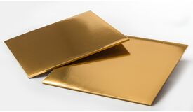 Golden plastic square tray isolated over white background